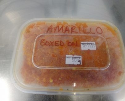 Picture of a frozen tub of Aji Amarillo chillies.