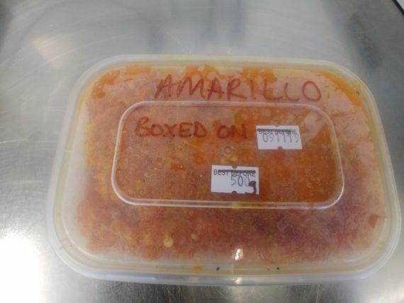 Picture of a frozen tub of Aji Amarillo chillies.